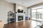 living-room-fireplace at #407 - 1150 Kensal Place, New Horizons, Coquitlam